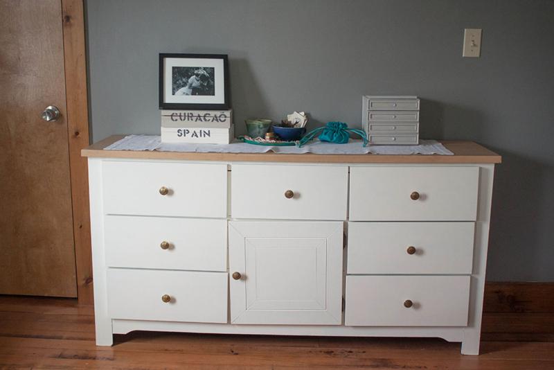 White dresser with vintage brass knobs