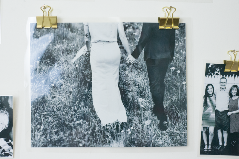 Laminate and hang photos with binder clips!