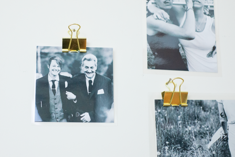 Laminate and hang photos with binder clips!