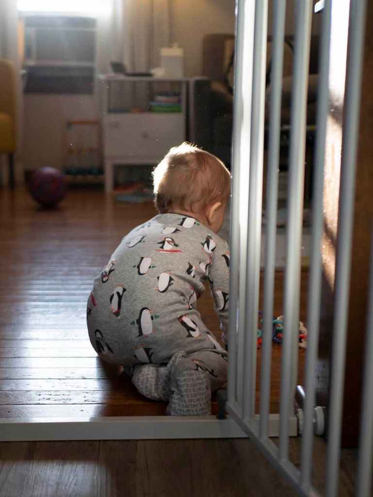 A baby crawling in morning light