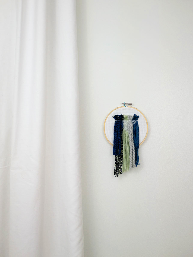 DIY yarn cross stitch wall hanging