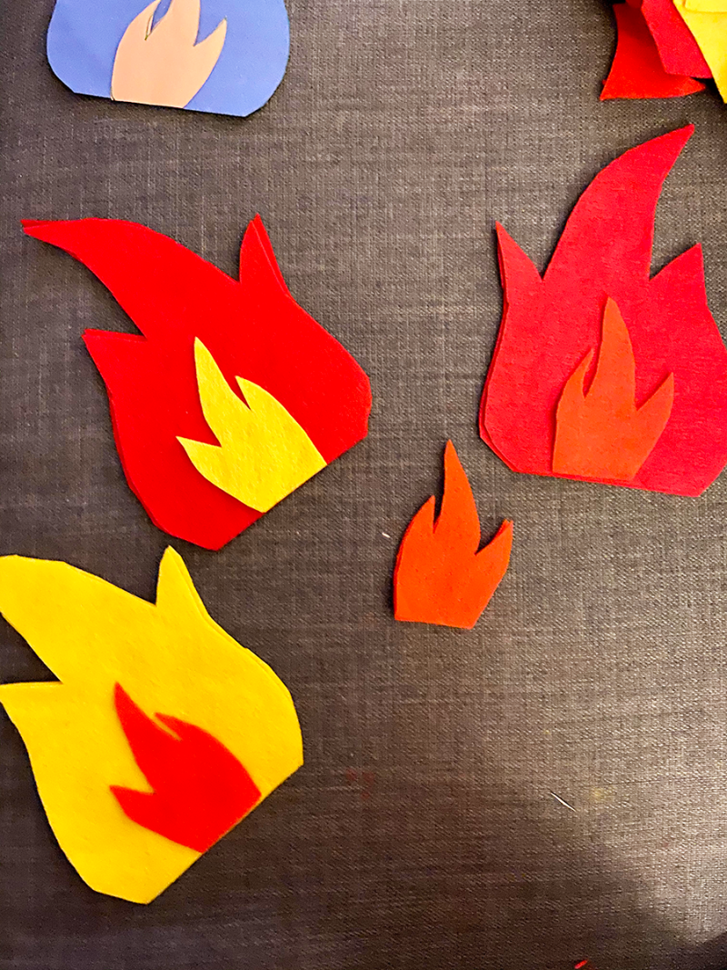Flame-shaped pieces of felt are cut out and being stitched together
