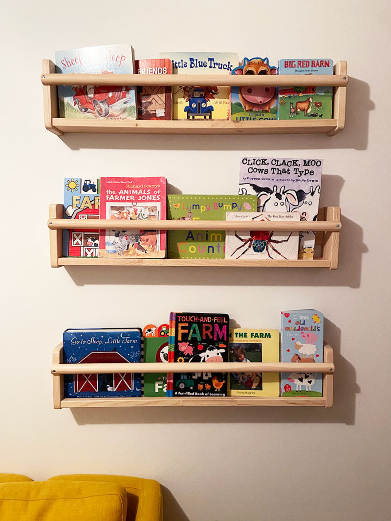 Three wall shelves are filled with farm-themed books