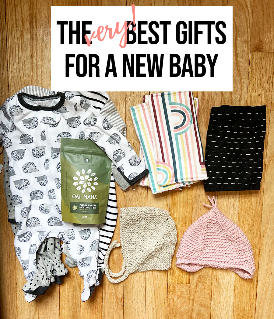 Baby gifts are displayed on a hardwood floor. There is a set of gender-neutral zip pajamas, a bag of postpartum healing tea, two hand-knitted baby hats, a pair of burp cloths with rainbows, and a black burp cloth stitched with white thread. The text The Very Best Gifts for a New Baby is at the top of the image.